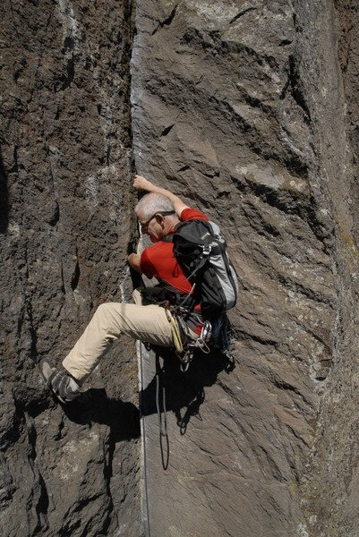 Rope soloing and just leaving the no-hands stem at the second nut placement to do the three or four moves to the top of the OW. The nut placement is back in the crack from my left hand on the flake and requires an extended trad draw.<br> <br> Photo: Jeff Thomas