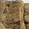 """Mid-way through the crux on the FA of our new route """"Full Moon Fever""""<br> Photo: Maidy"""