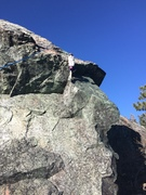 Cadence Brown pulling through the final roof on The Dogs Ear route