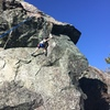 Cadence Brown at the top of the dihedral section moving onto the pillar of the Dogs Ear route