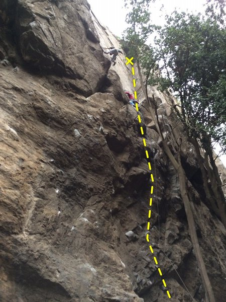 El Diedro (climber is at the ledge about to start up the corner)