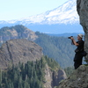 Don looking at Mt Rainier, with Shark Rock, Hat Rock, Mt Adams beyond, from base of Kirk Rock