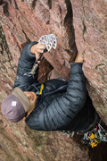 Joshua Munoz-Climbing False Perspective- Placing a #4 in the Crux Overhang. <br />Photo by Tommy Schuch