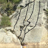 Downstream Crag, Main Slab.  (A) Easy Crack, 5.6; (B) Blade Runner, 5.10a; (C) Blade Runner Right, 5.9; (D) Lichen Face, 5.9