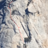 Photo of Tahquitz Rock, with the Fingertip Traverse route drawn on top. The photo is one I took with a 300 mm lens from the highway near Pine Cove.