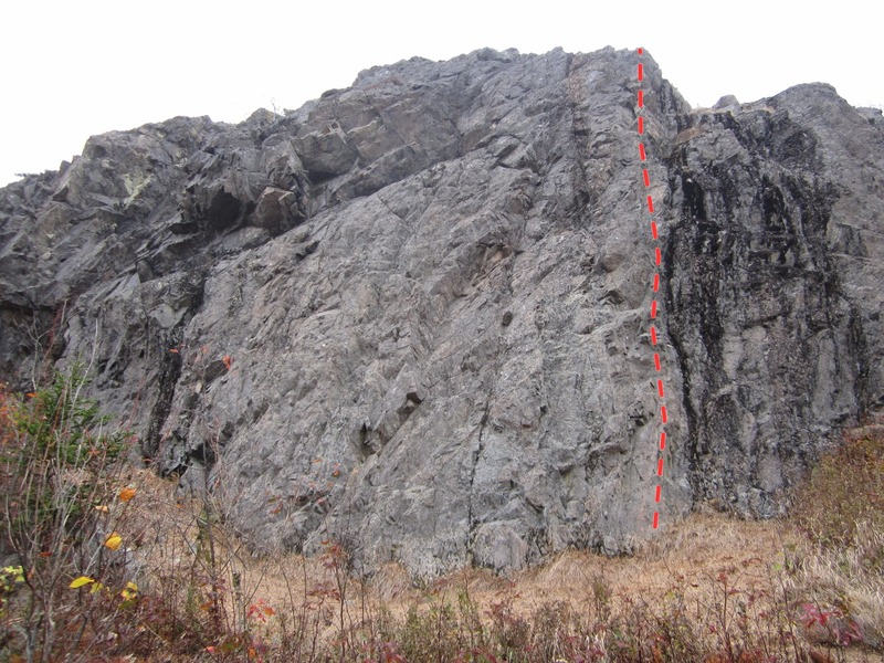 Photo showing right hand side of cliff. Red line is Lunch Break Arete.