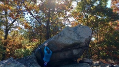 """Starting up the classic arete line """"Riptide"""" on the west end of the Back Door Boulder #1."""