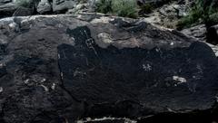 Panel on top of eastern boulder