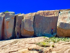 """yellow pages (freshman dome, enchanted rock)...see the climber to the right--he is on """"Right Book"""" (trad, build natural anchors at top)...crack to the immediate left is """"left book"""" (wider than Left Book, same anchor) walk off"""