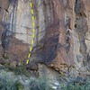 The white dihedral to the right of the vertical black and white stripes and to left of the arete.