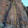 Climb up to the dihedral to the left of the arete. The dihedral ends and there's a section of juggy face climbing.