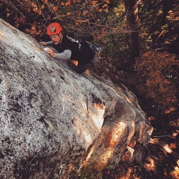 Drew Davidson working the low crux on the FA
