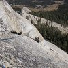 Tom Rogers on the crux of P3. The crux is a short section of slick granite for feet.