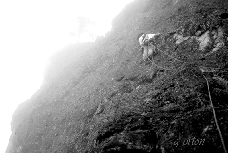 from pg. 57 of Rock Climbing Western Oregon, Mtn. 'N Air Books. Harold Hall leading the first on-site ascent of the Peregrine Traverse, Pitch 2 in heavy cloud cover, August 1997. This was our third pioneered route on Acker that August after completing Maltese Falcon and Black Magic. g orton