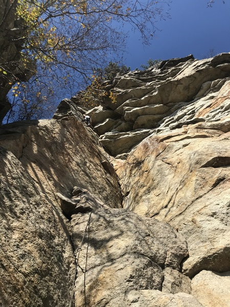 Russ Clune enjoys a perfect fall day at Skytop on the crux moves of Taste of Honey.