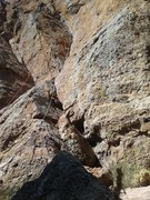 Mike is at the first anchor station on Jorgie's Crack.  The route follows the dihedral to the right of him.  The red rope on the left is on Swallow Crack.
