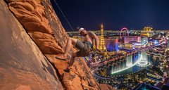 """Derek Rapping """"The Die is Cast"""". The climb has a great view of Vegas as you can see."""