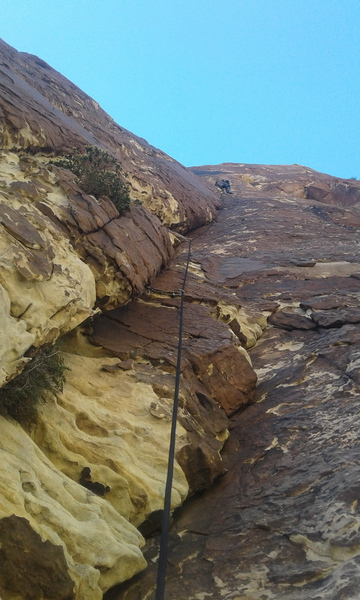 Headed up the crux pitch. Sustained 5.9 climbing with a short, well protected 5.10 move at the top.