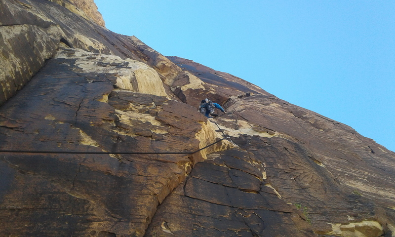 Pitch 8. Step right from the chains, head up to the right side of the roofs, then drift left and up to the belay ledge.