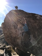 Mother of Invention. Chris Blakslee bouldering with pup Cosmo looking on.