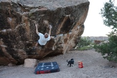 Right after sticking the crux left hand, time to squeeze before the lip!