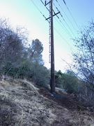 There is a new all steel power pole just up the trail. It has the number 46 on the yellow tag. Go left at the pole.