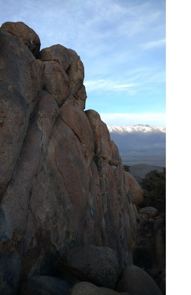 View from the left side of the wall with the White Mountains in the background. Silver Lining is the leftmost crack, Second Strike has the fresh bolts.