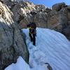 Ethan Davis getting into some snow between golden granite on the Upper Exum, July 2017
