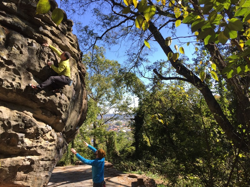 "Climbers enjoying a great fall day on the Cliffhanger Boulder, finishing up the ""Cliffhanger"" boulder problem (v0-1)."