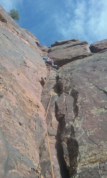 Climbing to the two bolt anchor.