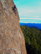 Logan Wetherell on pitch 3 of Big Balls in Cow Town (5.10b), McKinley Rock with Mtn. Bailey in the background. g Orton