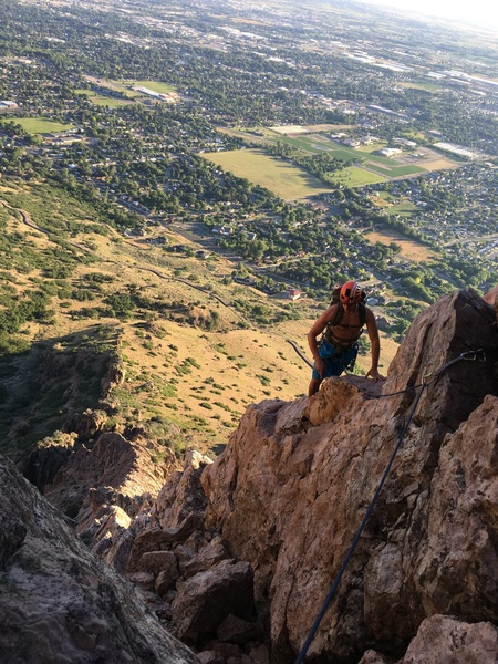 Johnny with views of North Ogden below him. Top of P2