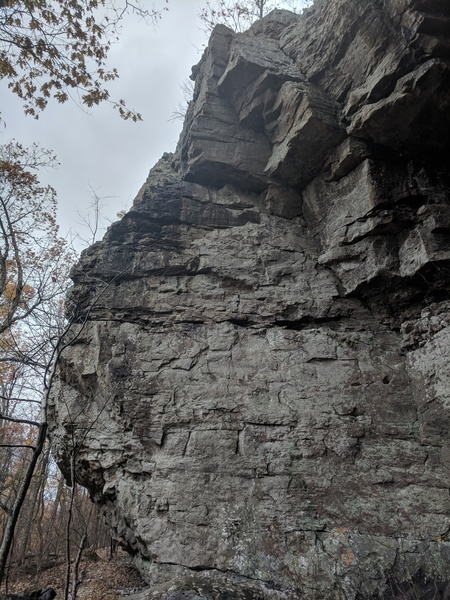 Climbs up the middle of the wall and onto the arete near the top