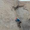 Jaeson climbing past the first bolt.