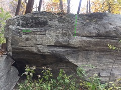 Not the large ledge on top of the overhang.  The flat edge on the right side of it.