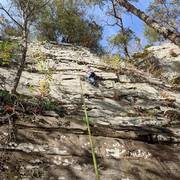 Sofia (age 9) works her way up Buckets. The route is right of Elephant Crack, to the right of the ledge full of vegetation.