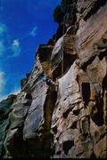"""Miki Enoeda contemplates the crux of """"Miki's climb"""", 1994."""