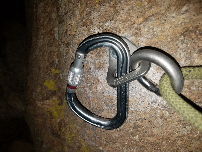 Never happened to me before but..... I got my carabiner wedged and couldn't free it without SERIOUS yanking, so I let it stay. Left bolt on the chockstone.