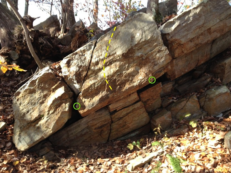 """The overhung block of the baby roof. """"Misty Green"""" V2-3 in yellow with start holds in green."""