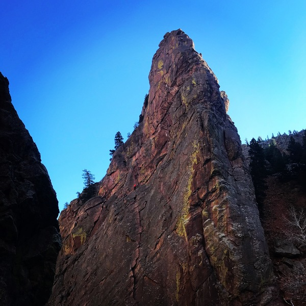 A party seen at the start of the 3rd pitch of the Bastille Crack (in red); taken from the Whale's Tail.