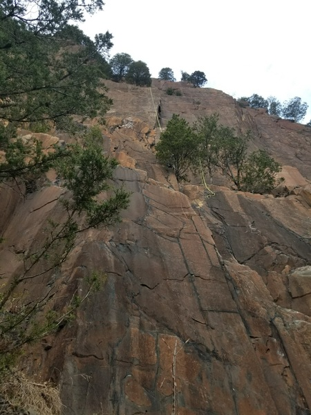 Route starts after scrambling about a third of the way up to the roomy ledge inside the right-facing corner. 