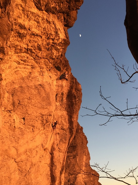 Adam Tripp on the P2 crux shared with Boulder Problem in Space during Golden Hour.