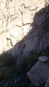 Start of route(s) and best belay location. Thomas Pham FA of Worth the Stay(5.9), Marta Reece belaying, Drew Chojnowski in green.
