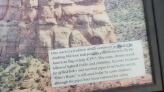 Detail of a plaque that records John Otto's first ascent of the monument.