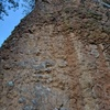 Leftmost route on wall, climbs up just right of the arete