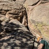 Jon racks up at the base of Serpentine Crack