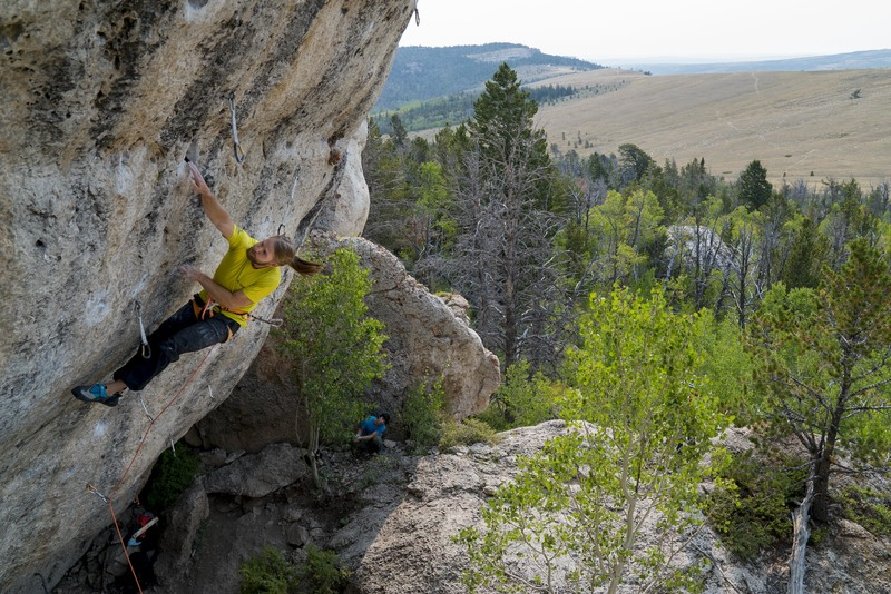 Darren Flack moving through the upper section of Atomic Cow, 5.13d