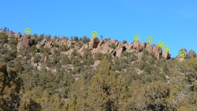 The view of Sprocket Rocks from approach. Arrows mark the spots with routes.
