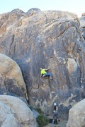 Climbing through the new crux sequence. 