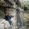 Ben found a ledge next to a waterfall.